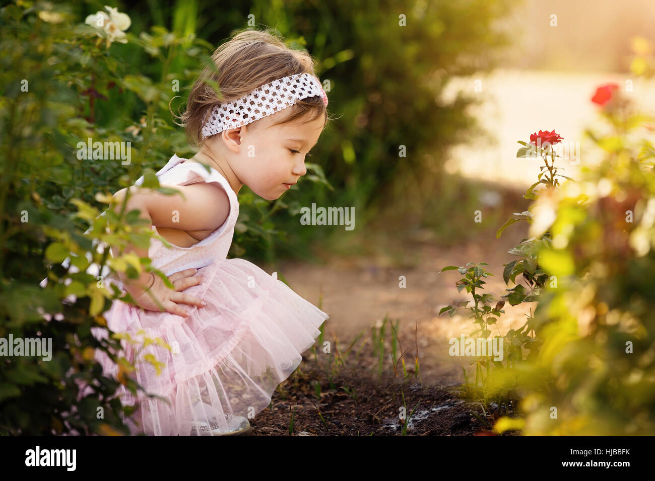 Gorgeous little girl outdoors in green garden Stock Photo: 131786919 ...