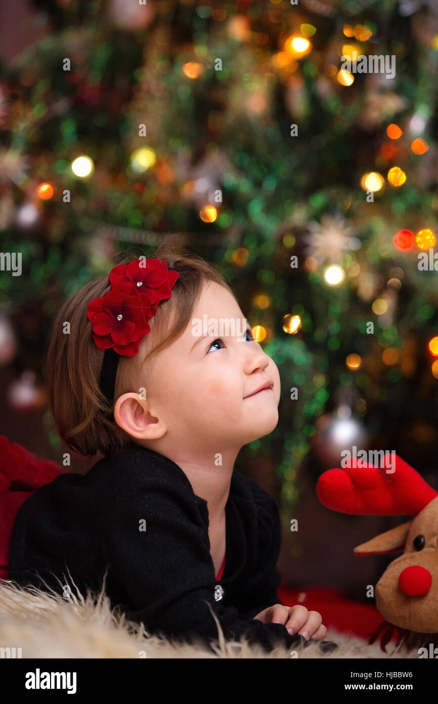 Beautiful Little Girl Looking Up Expecting Her Christmas Gifts Stock ...