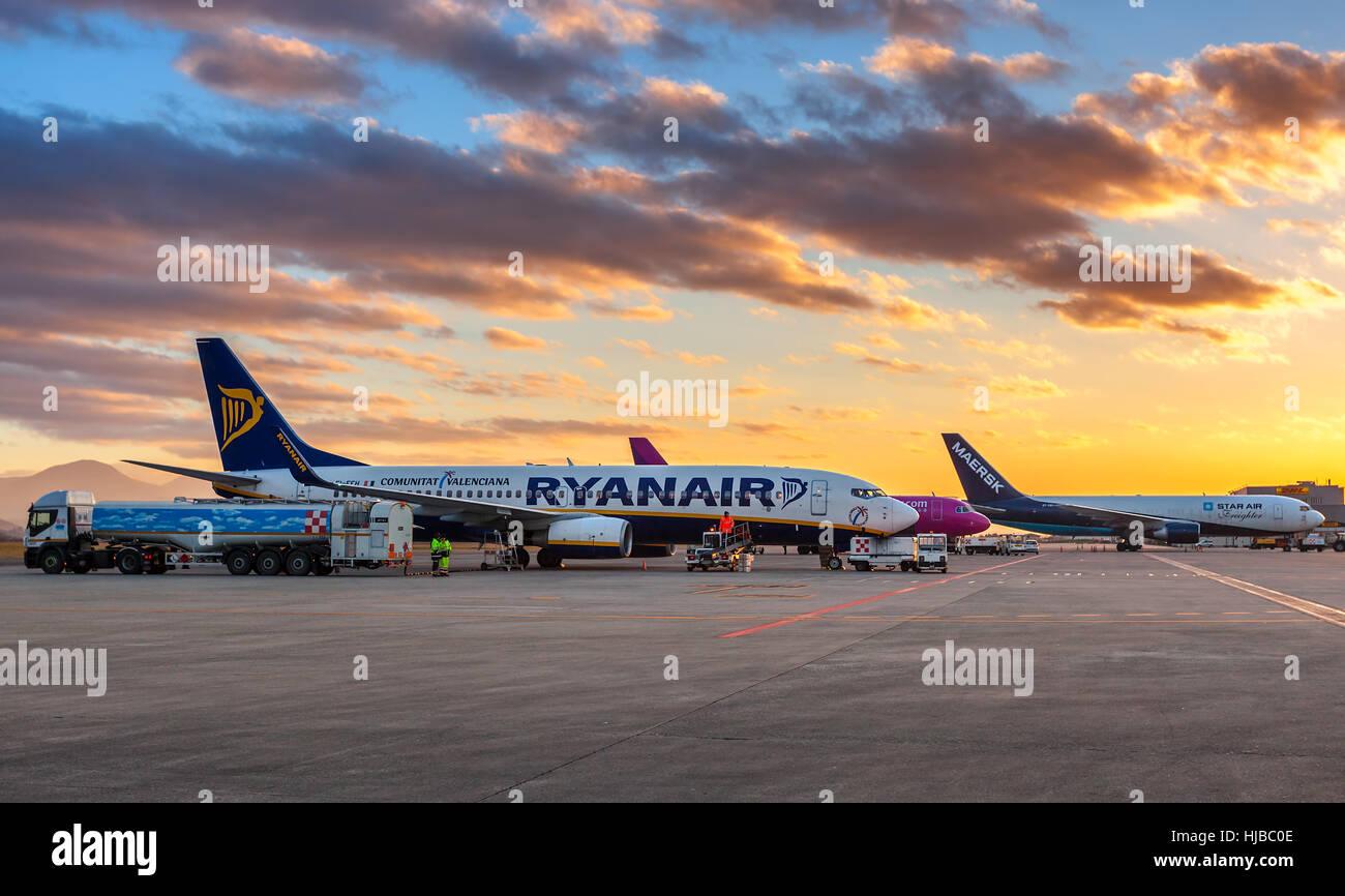 Ryanair airplane on the parking under beautiful morning sky at Orio al Serio International Airport. - Stock Image