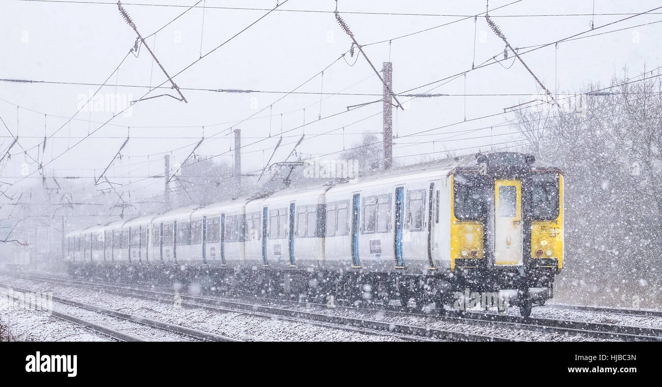Class 317 Electic Multiple Unit , 317337 Seen In A Snow Storm, Brookmans Park, Hertfordshire, England, UK - Stock Image
