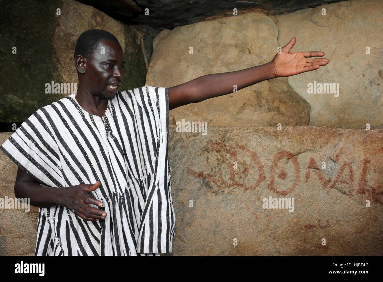 Ghanaian Guide In Cave At Talensi Tribal Village - Tengzug, Ghana - Stock Image