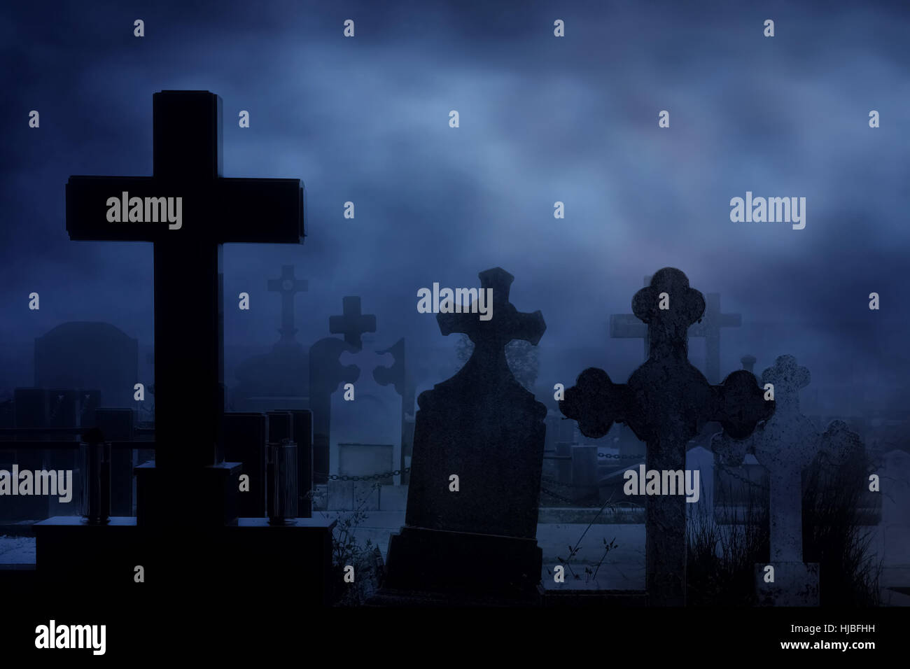 cemetery at night - Stock Image