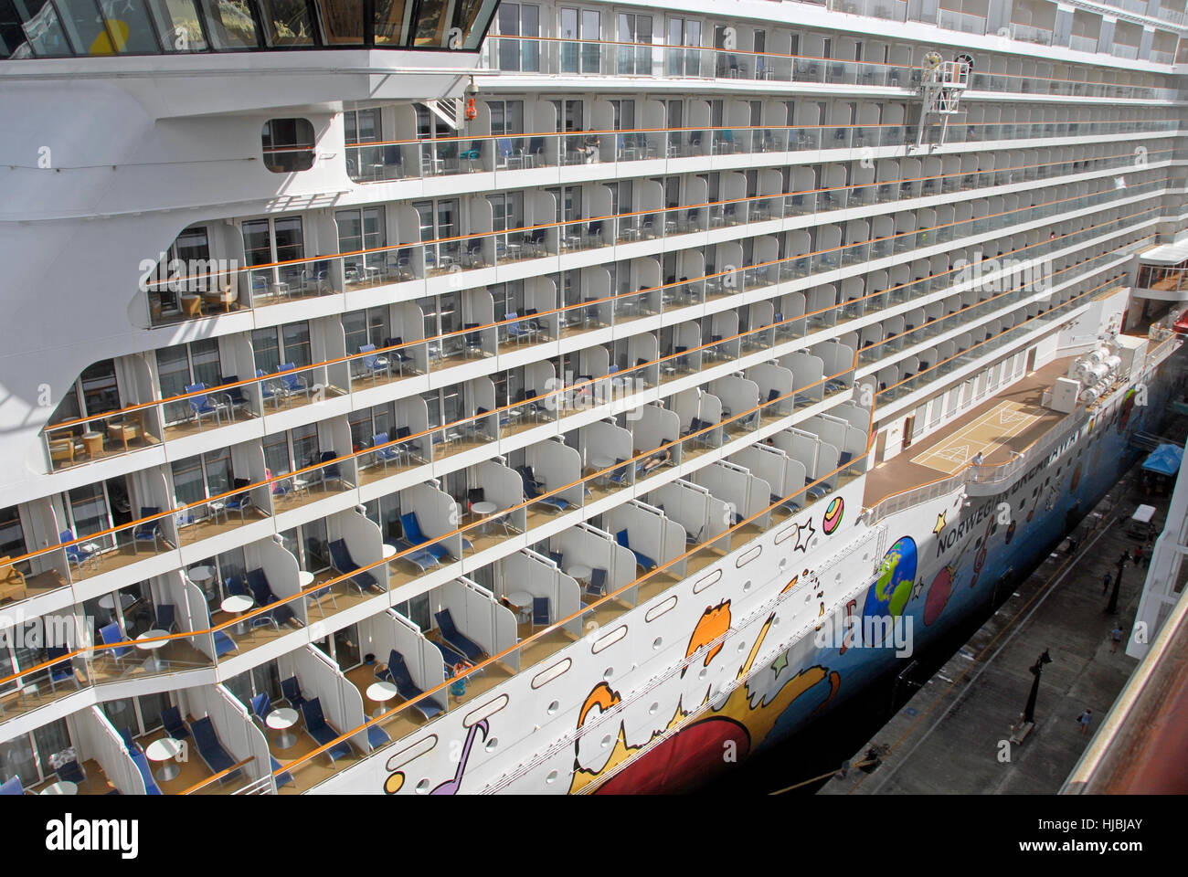 Rows of cabin balconies on large cruise liner - Stock Image