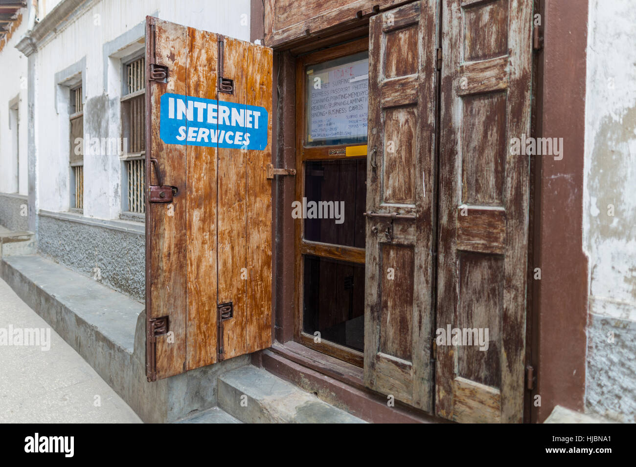 Stone Town, Zanzibar, Tanzania- October 2016:Internet usage is becoming more common in poor parts of Africa like - Stock Image