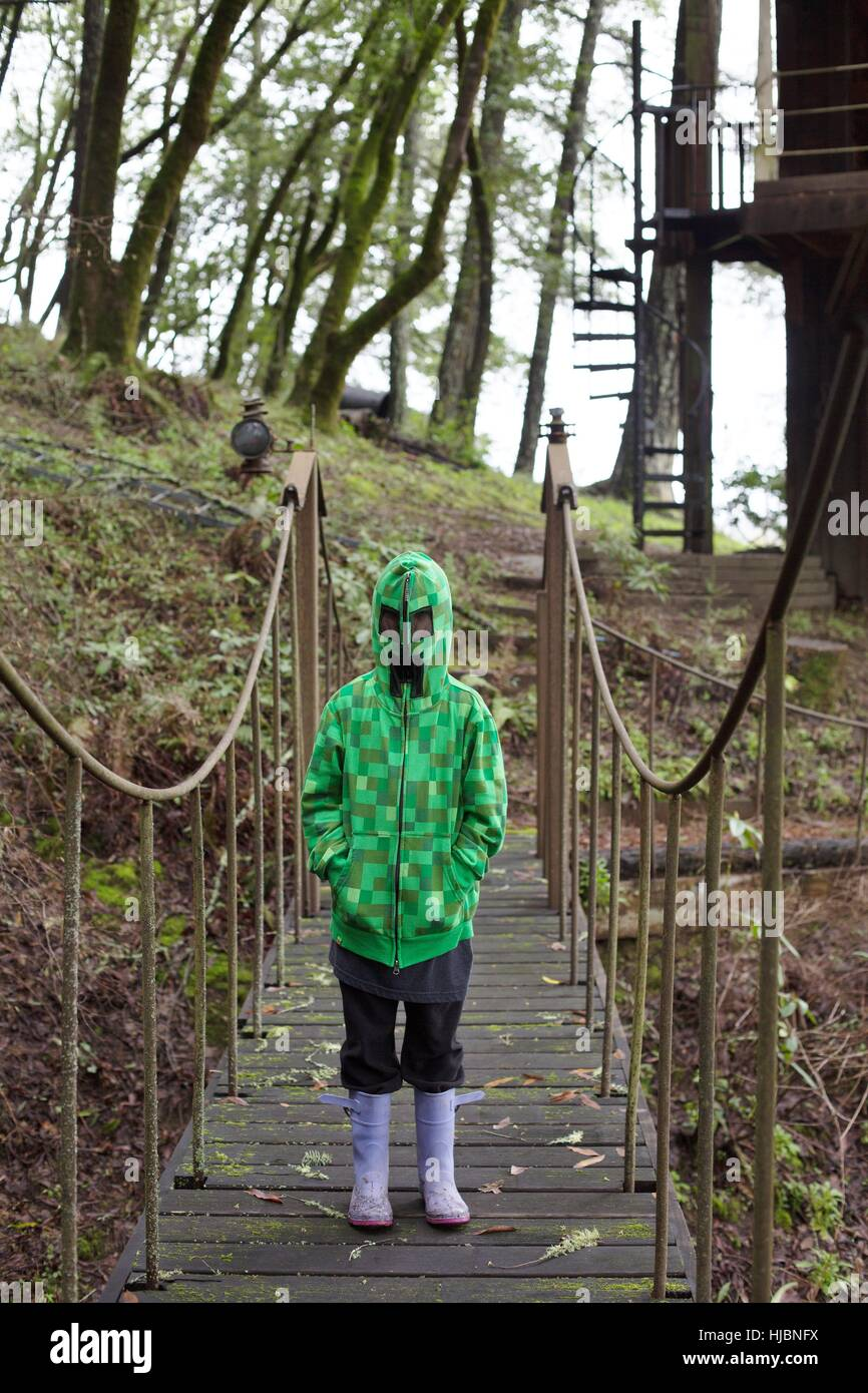 A child wearing a Minecraft Creeper jacket. - Stock Image