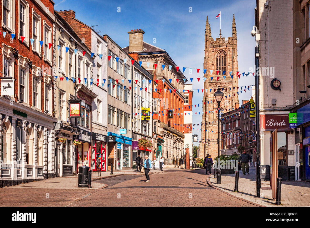 People shopping in Iron Gate in the centre of Derby, England, UK - Stock Image