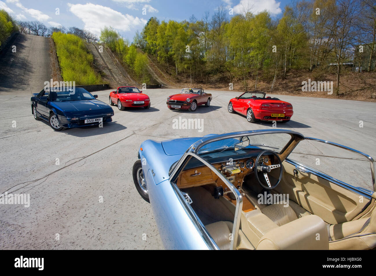 Open top classic sports cars from the 60s, 70s, 80s, 90s and 00s, in that order: Lotus Elan, MGB, Toyota MR2, Mazda - Stock Image