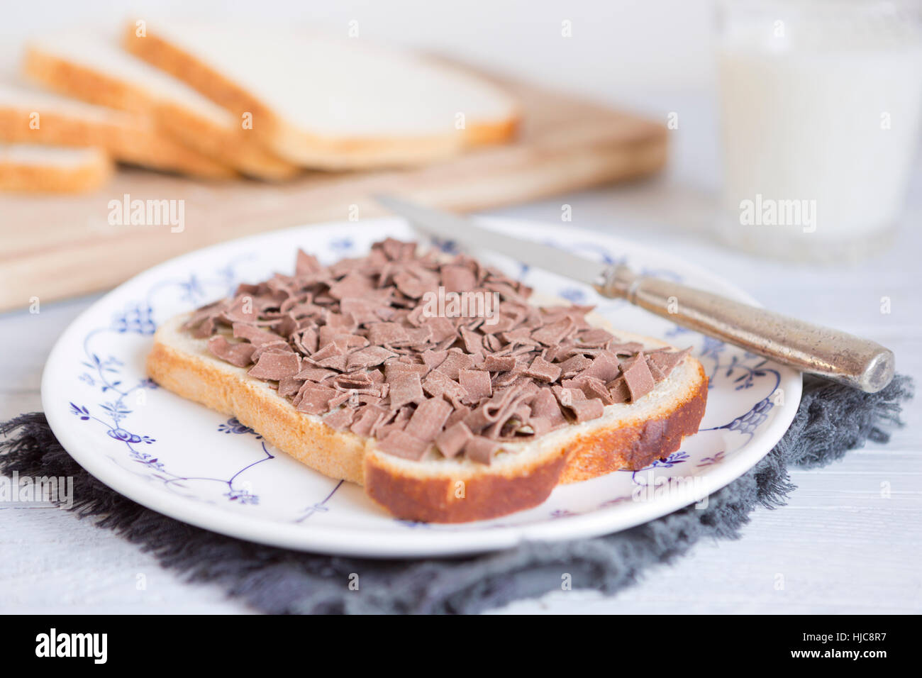 A sandwich with chocolate sprinkles or 'vlokken', Dutch traditional food. - Stock Image