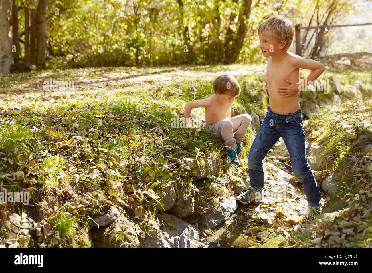 Two boys exploring outdoors, Schluderns, South Tyrol, Italy - Stock Image