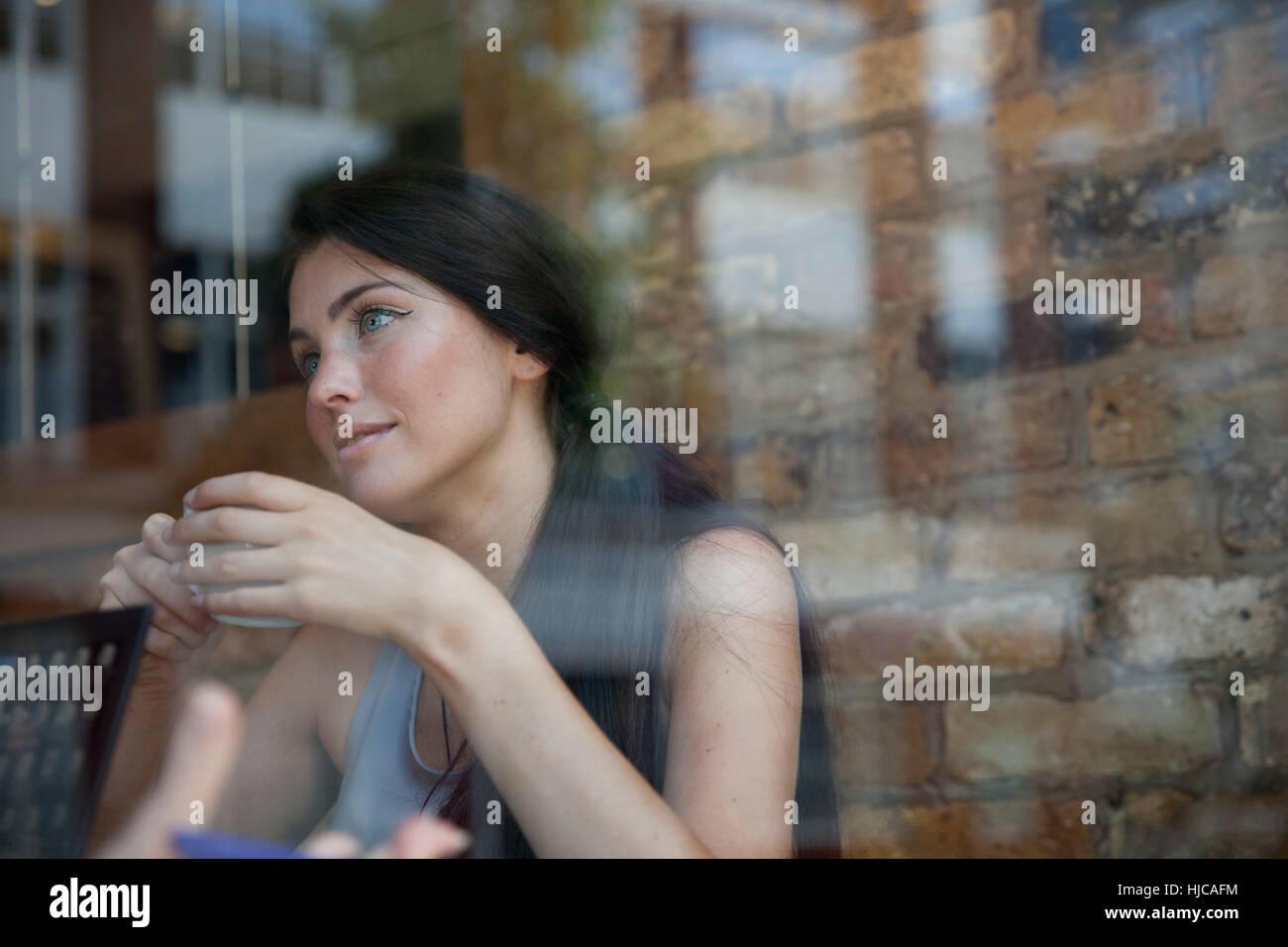 Businesswoman having meeting in coffee bar, London - Stock Image