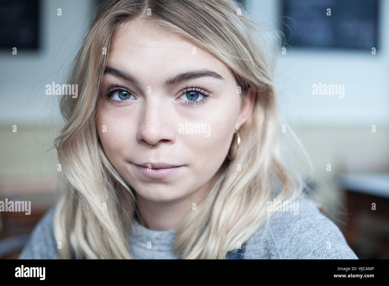 Portrait of young woman, in cafe Stock Photo