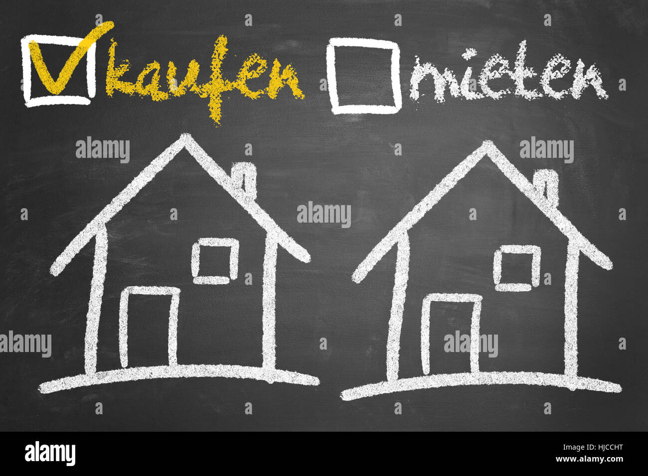 Concept on blackboard with German text 'kaufen' (buying) and 'mieten' (renting) - Stock Image