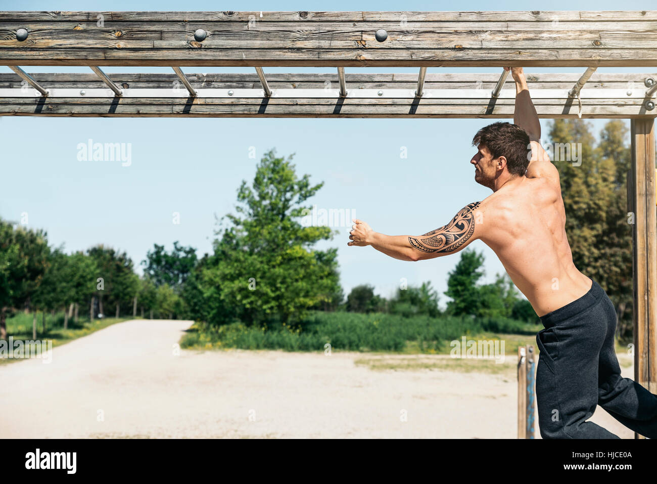 Fitness, workout, sport, lifestyle concept. Man training fitness in the sport area. - Stock Image