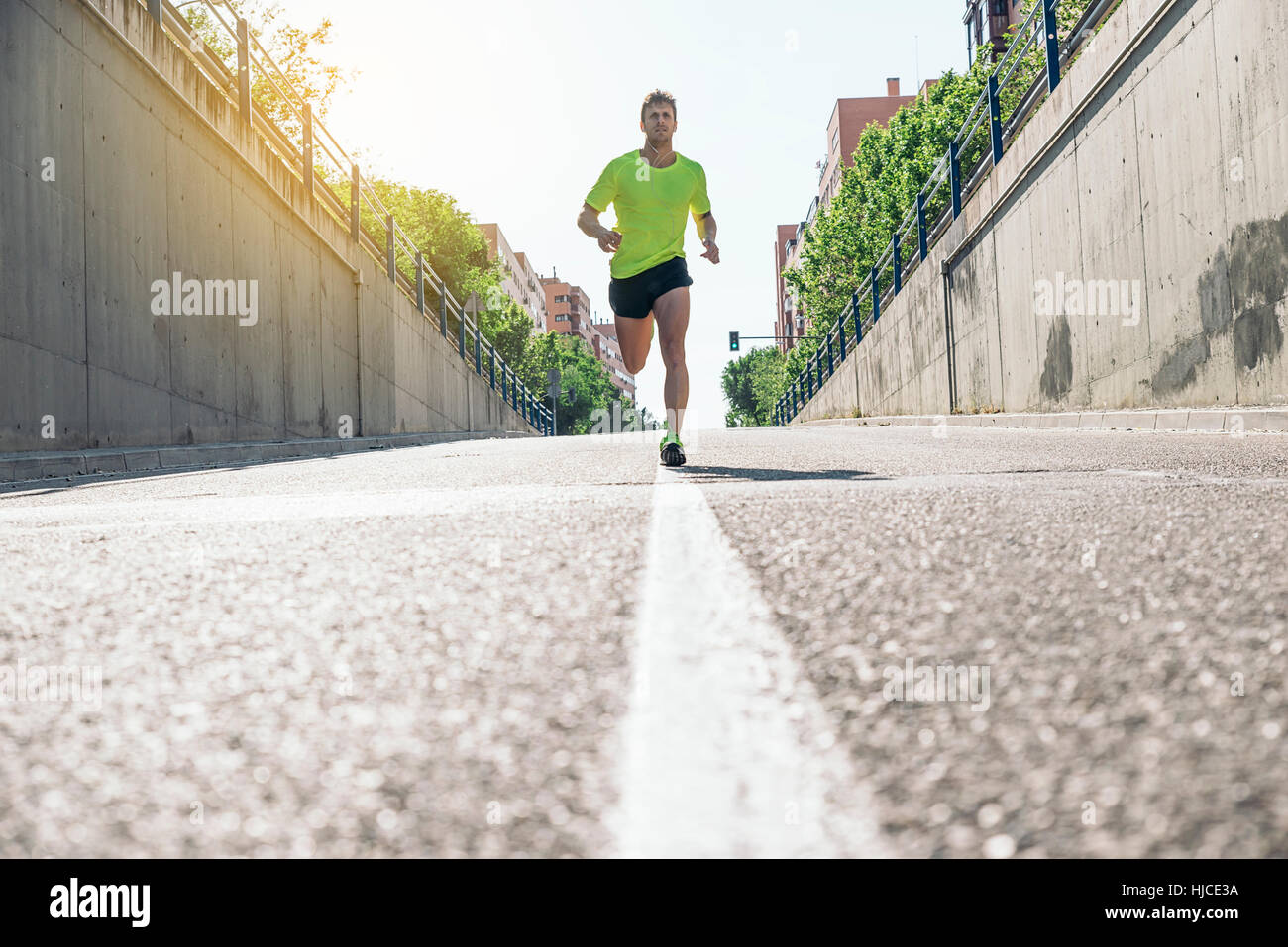 Fitness, workout, sport, lifestyle concept. Man running in the city. - Stock Image