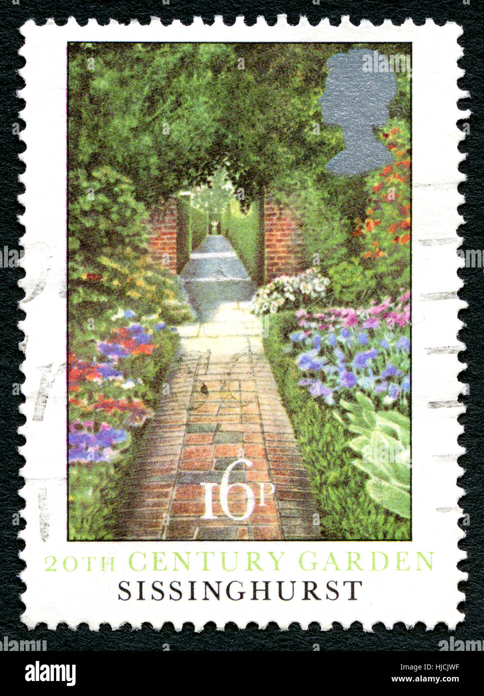 GREAT BRITAIN - CIRCA 1983: A used postage stamp from the UK, depicting an illustration of Sissinghurst Garden from - Stock Image