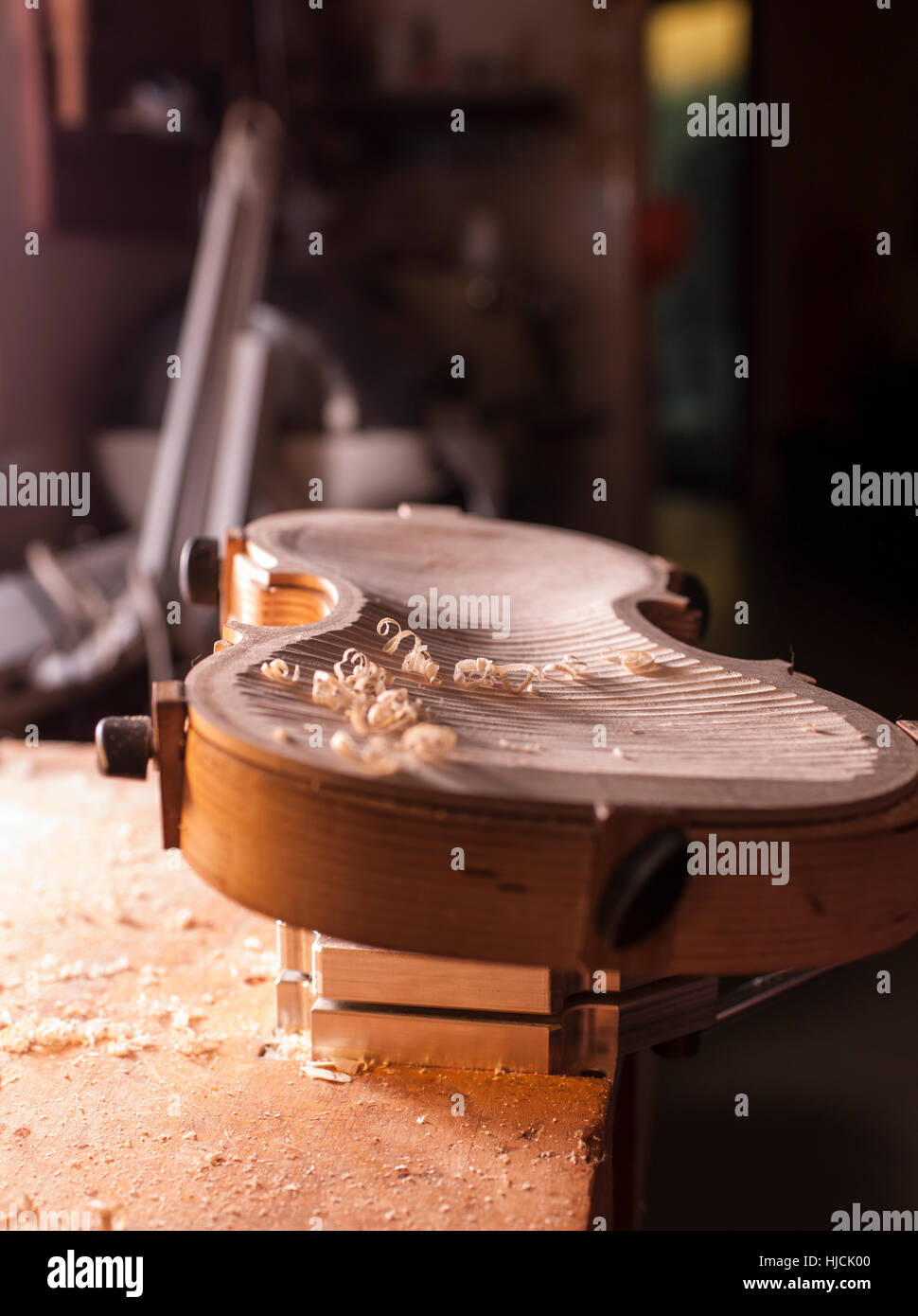 Woman violin maker, luthier, at work in her laboratory in Cremona, Italy Stock Photo