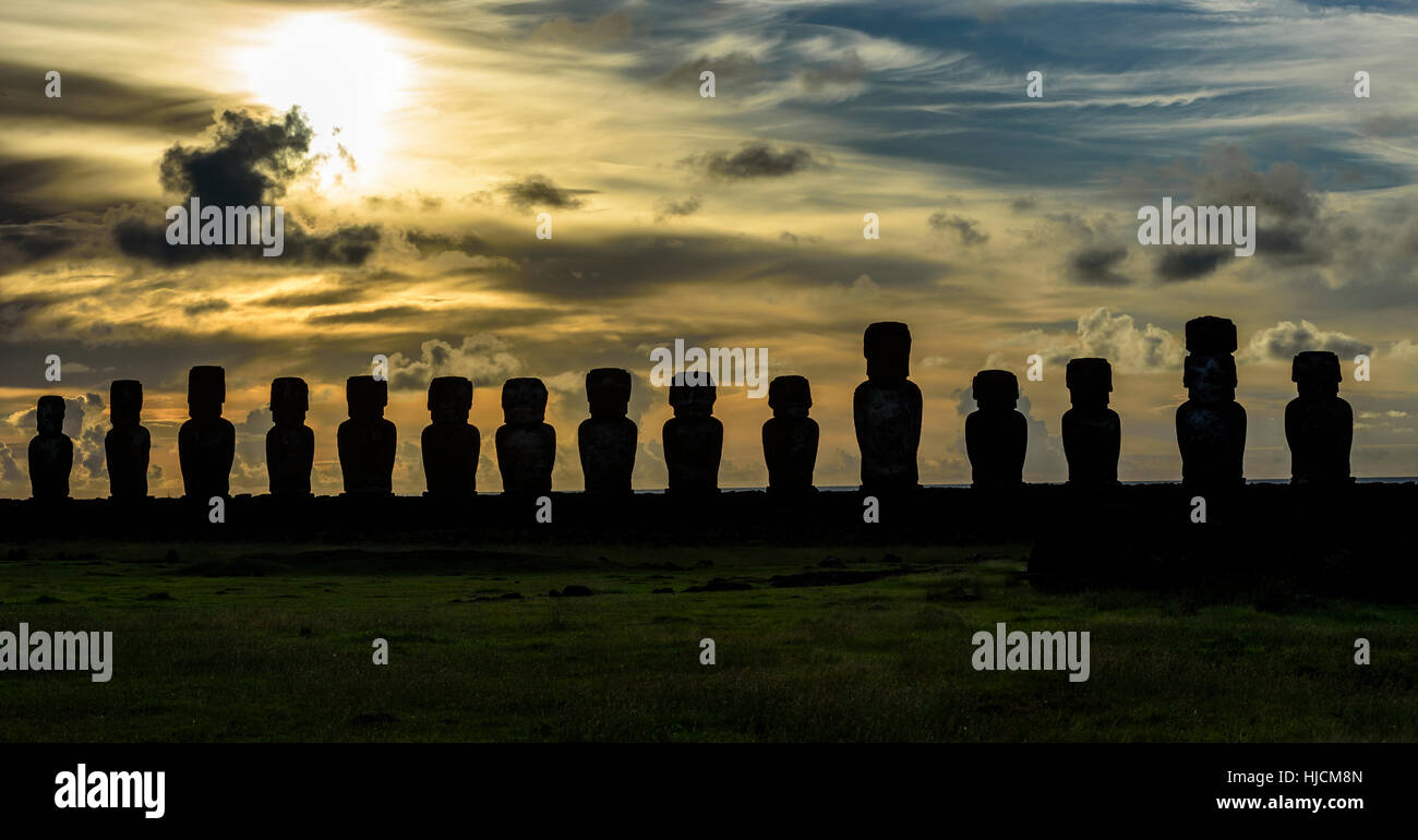 Sunrise on Moai  at Tongariki ceremonial platform in Easter Island.Tongariki is the largest platform (Ahu) with - Stock Image