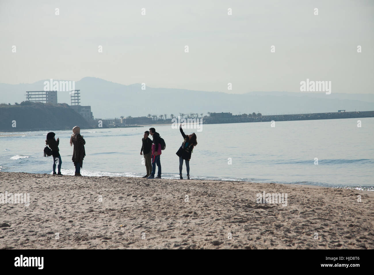 Beirut, Lebanon. 24th Jan, 2017. People enjoy the winter sunshine and unusually warm temperatures on Beirut beach - Stock Image