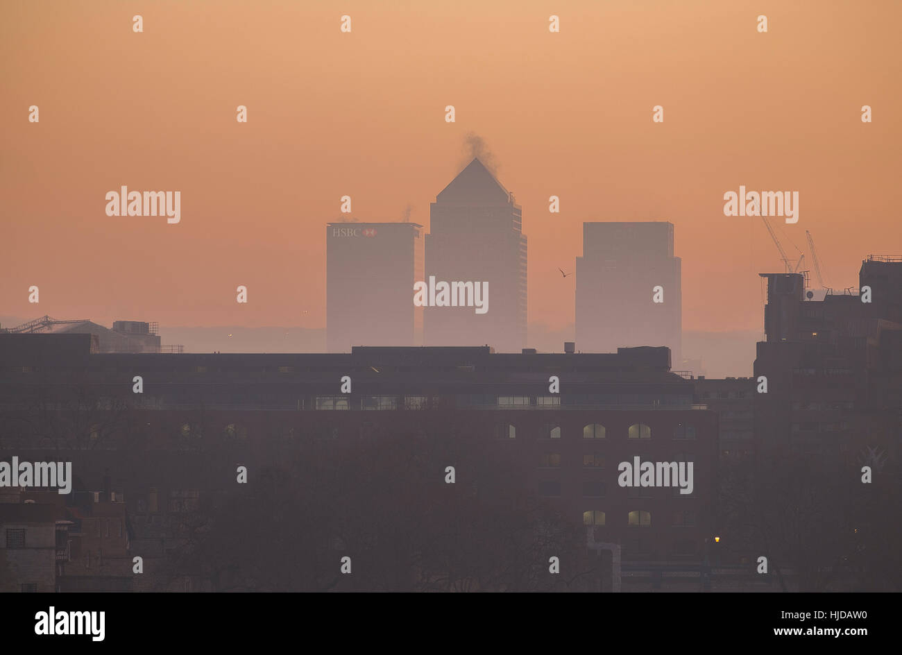 Canary Wharf, London, UK. 24th January, 2017. London Mayor Sadiq Khan has issued a very high air pollution alert. - Stock Image