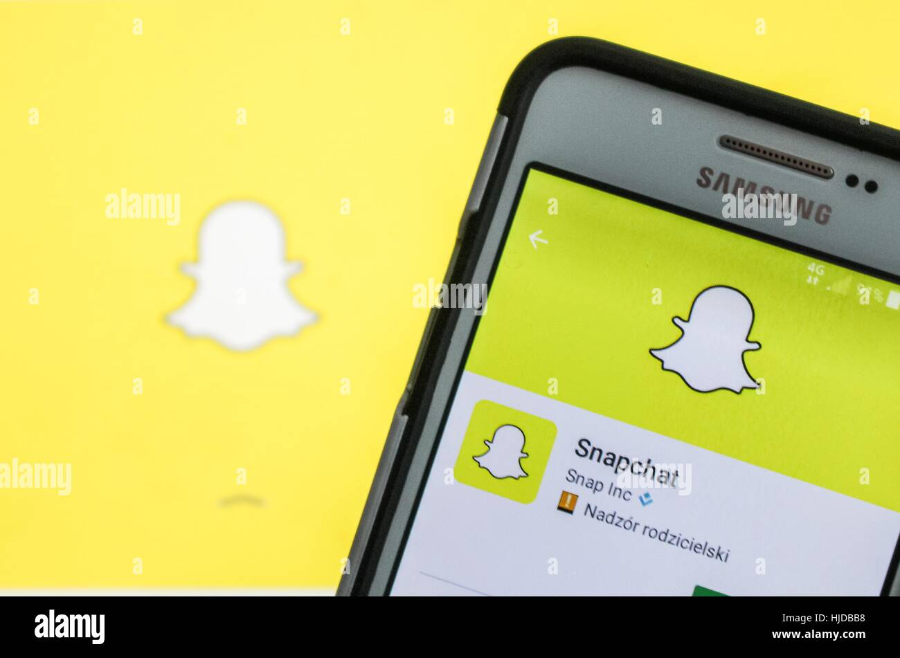 Man holding Samsung smartphone in hand, with Snapchat app