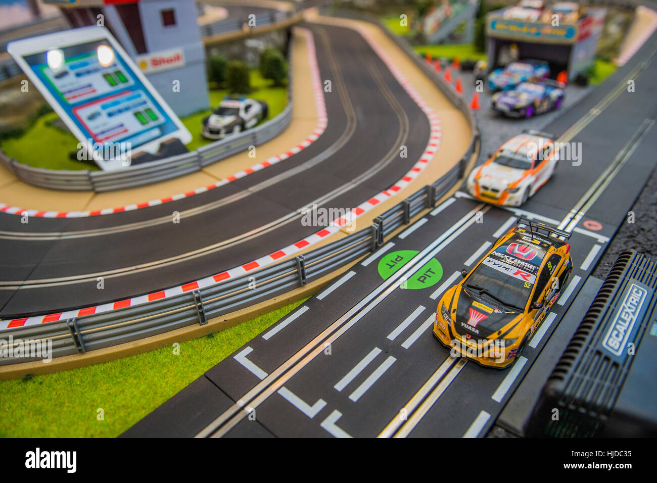 London, UK. 24th Jan, 2017. Tablet app controller and Scalextrics set on the Hornby stand - The London Toy Fair - Stock Image