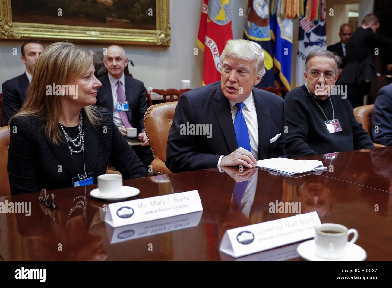 Washington, USA. 24th Jan, 2017. US President Donald Trump (C), with CEO of General Motors Mary Barra (L) and CEO Stock Photo