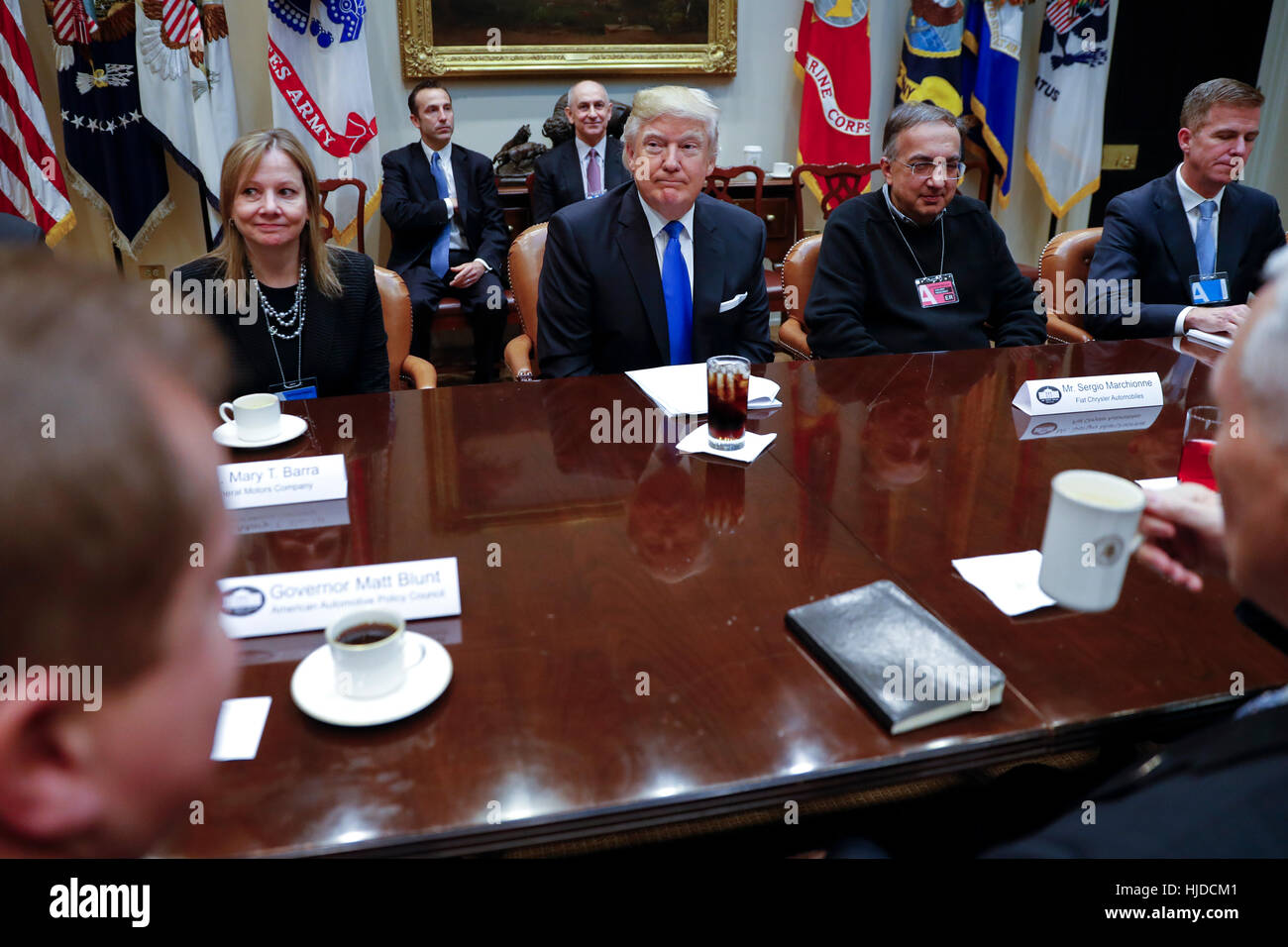 Washington, USA. 24th Jan, 2017. US President Donald Trump (C), with CEO of General Motors Mary Barra (L), CEO of Stock Photo