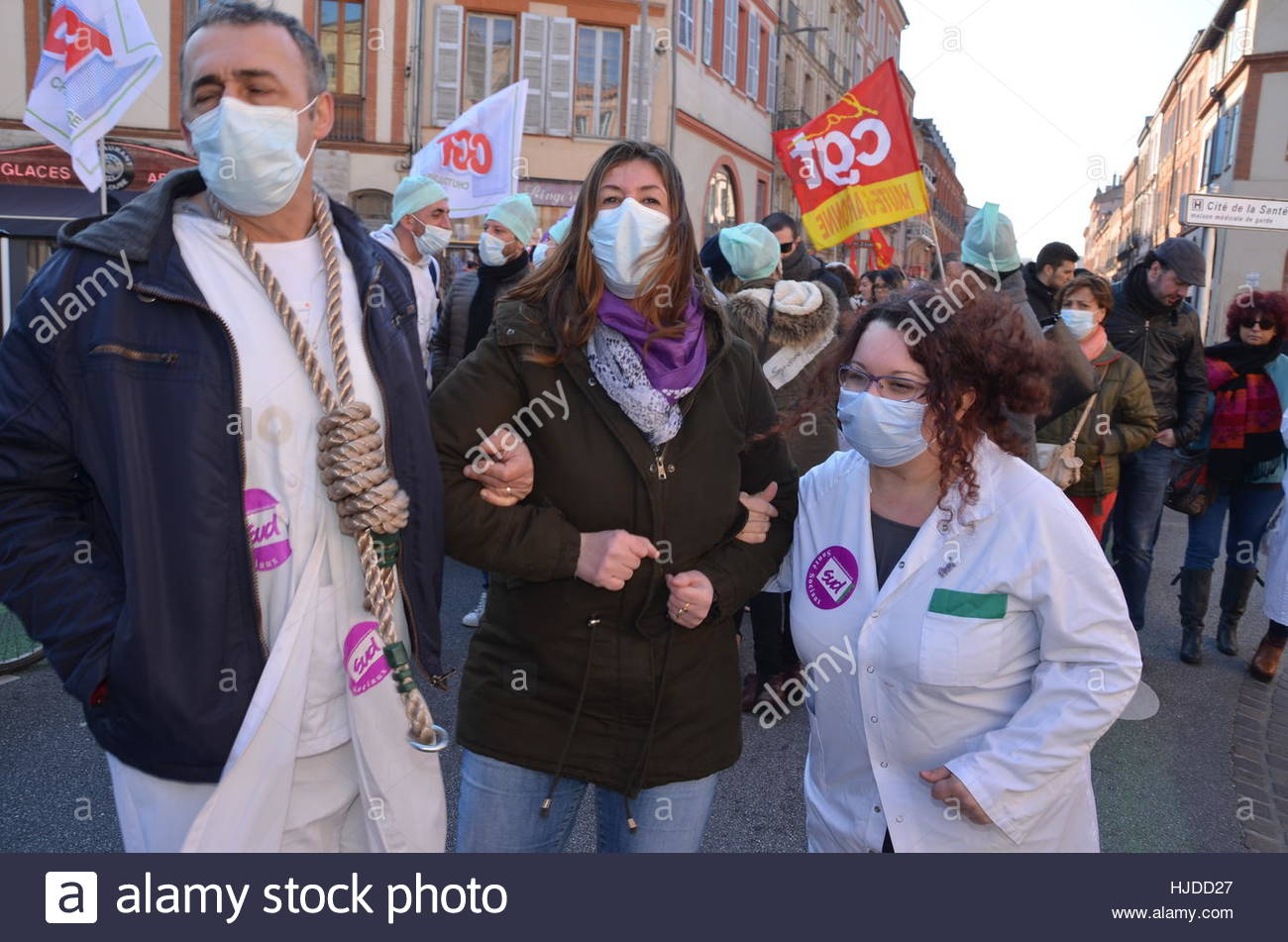 Toulouse, France. 24th Jan, 2017. Protesters don medical masks as, at the call of healthcare worker unions, nurses, - Stock Image