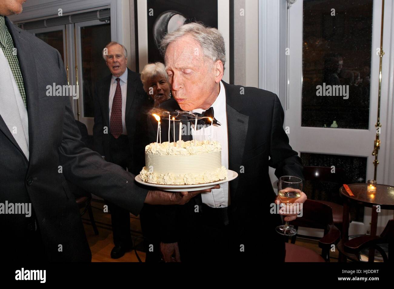 New York USA 23rd Jan 2017 Dick Cavett Blowing Out Candles On His Birthday Cake At Arrivals For Cavetts 80th Party Private Midtown Club