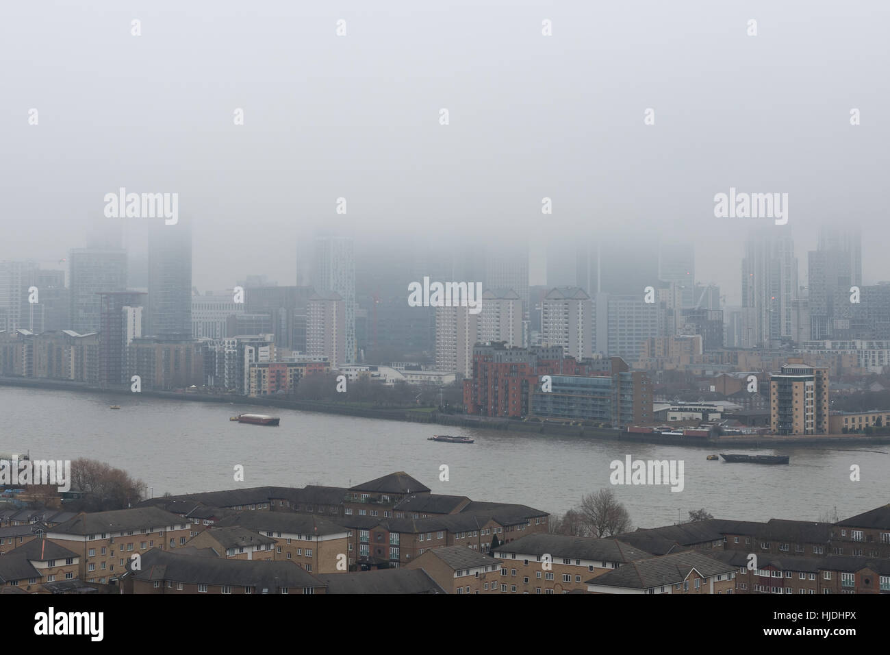 London, UK. 25th January, 2017. UK Weather: Heavy fog continues over London and Canary Wharf business park buildings Stock Photo