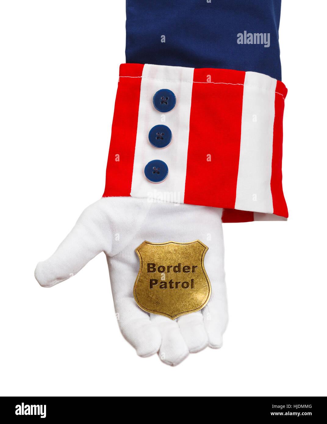 President Holding Border Patrol Badge Isolated on White. - Stock Image