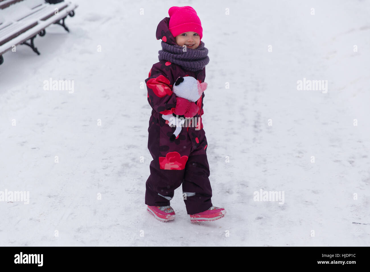 Small child in winter park - Stock Image