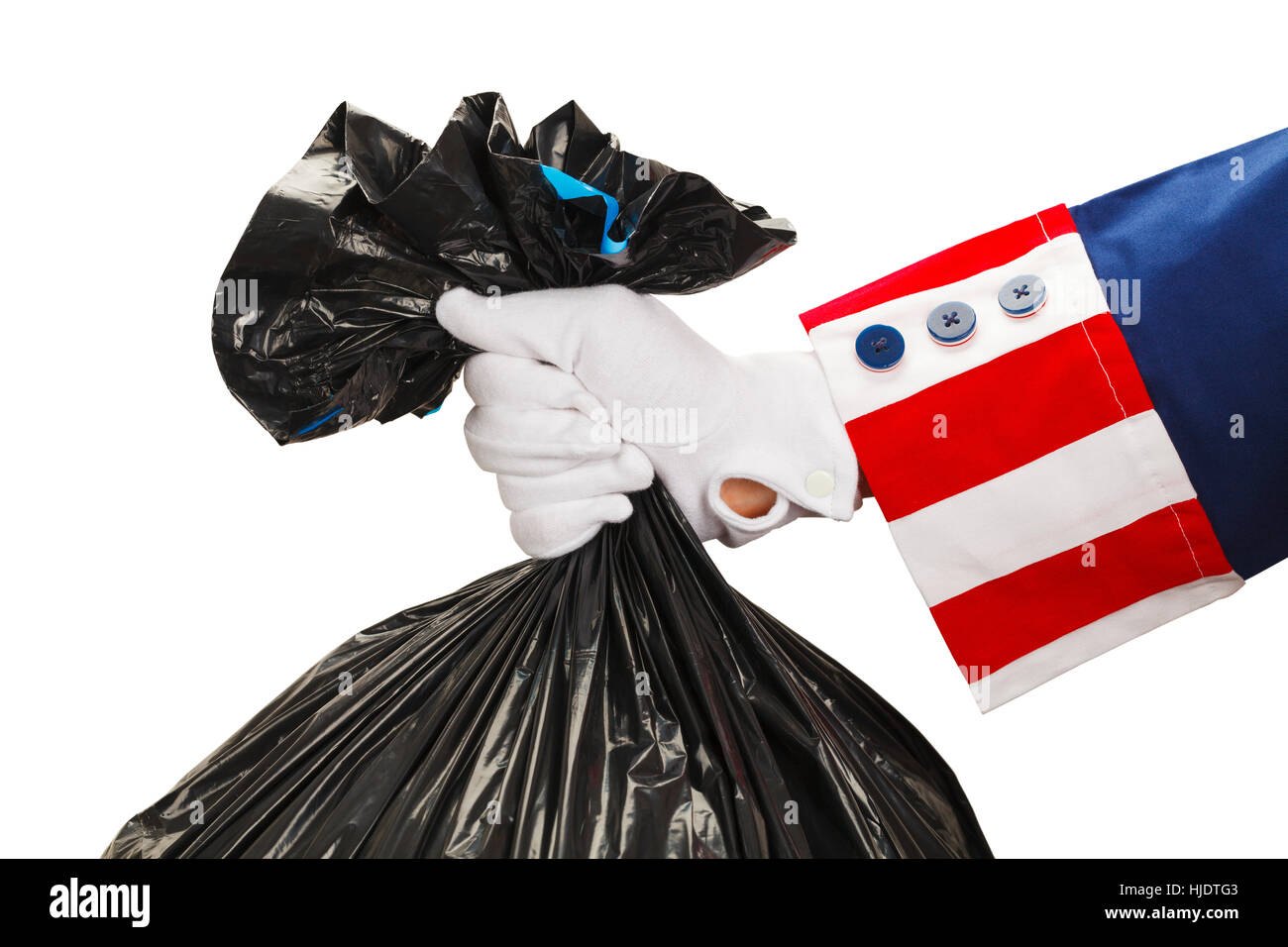President Holding a Bag of Trash Isolated on White Background. - Stock Image