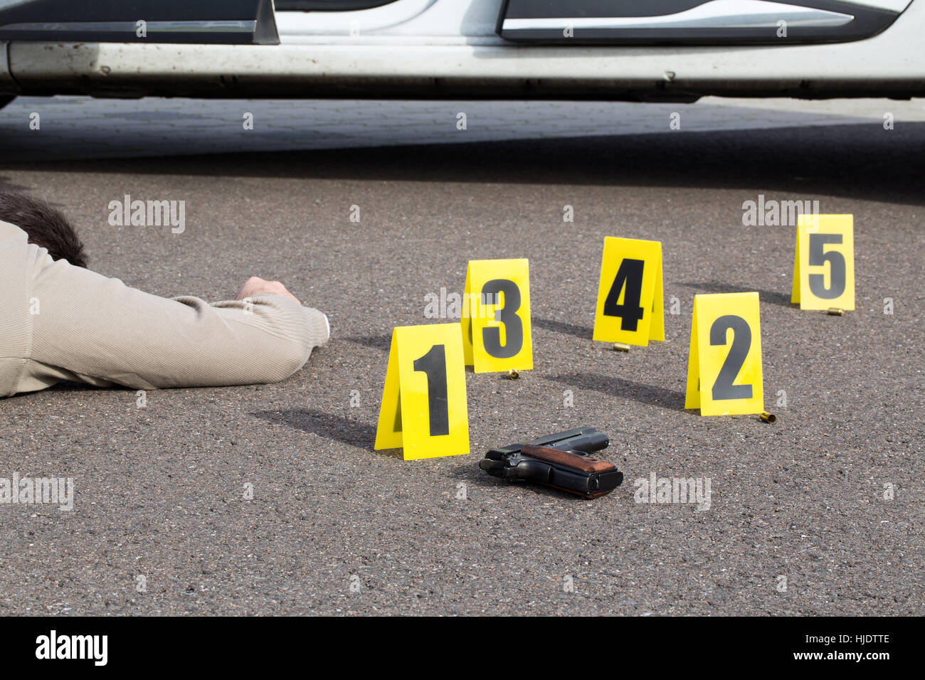ID tents at crime scene after gunfight - Stock Image