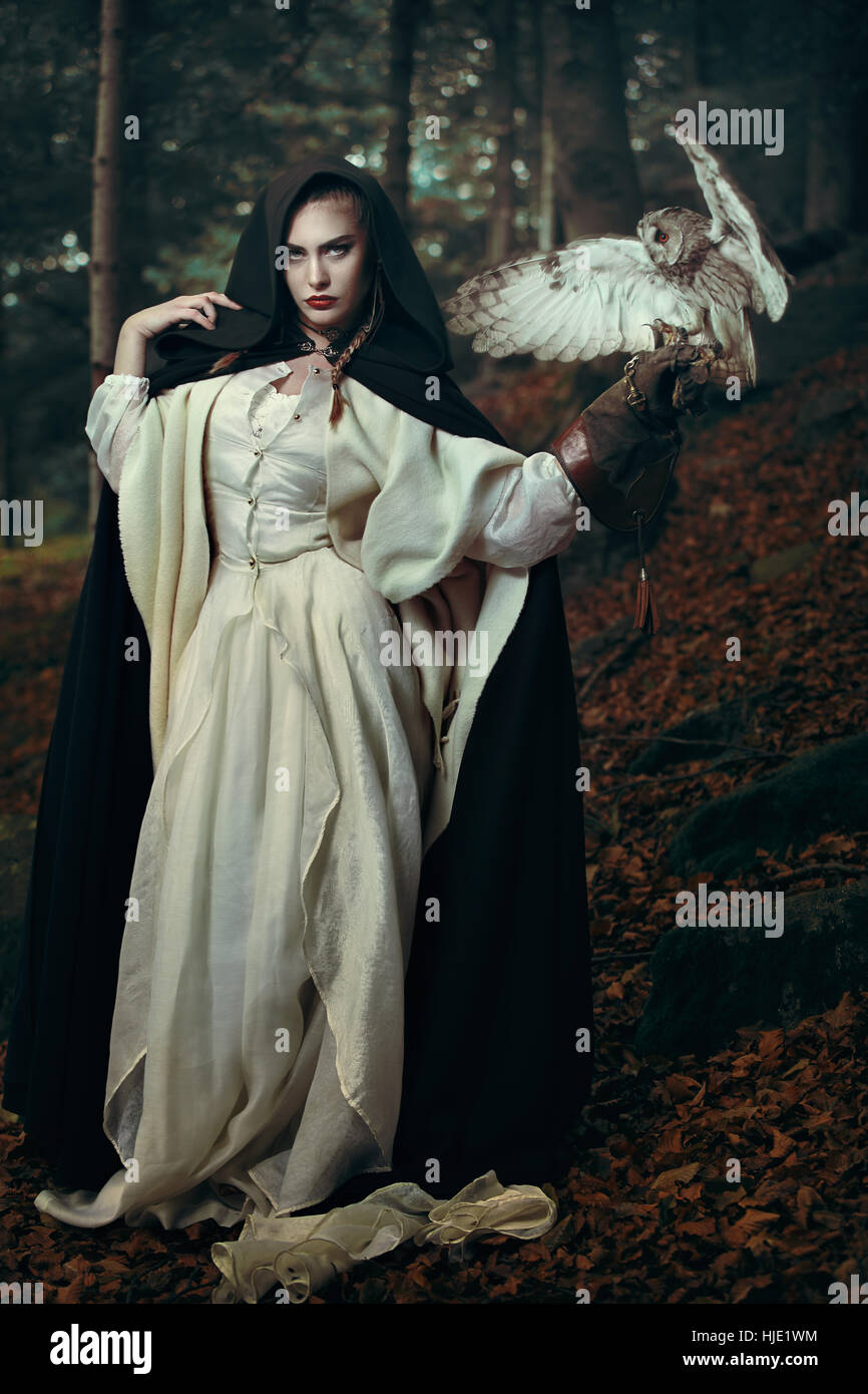 Beautiful lady of the forest with her owl .Fantasy and fairytale - Stock Image
