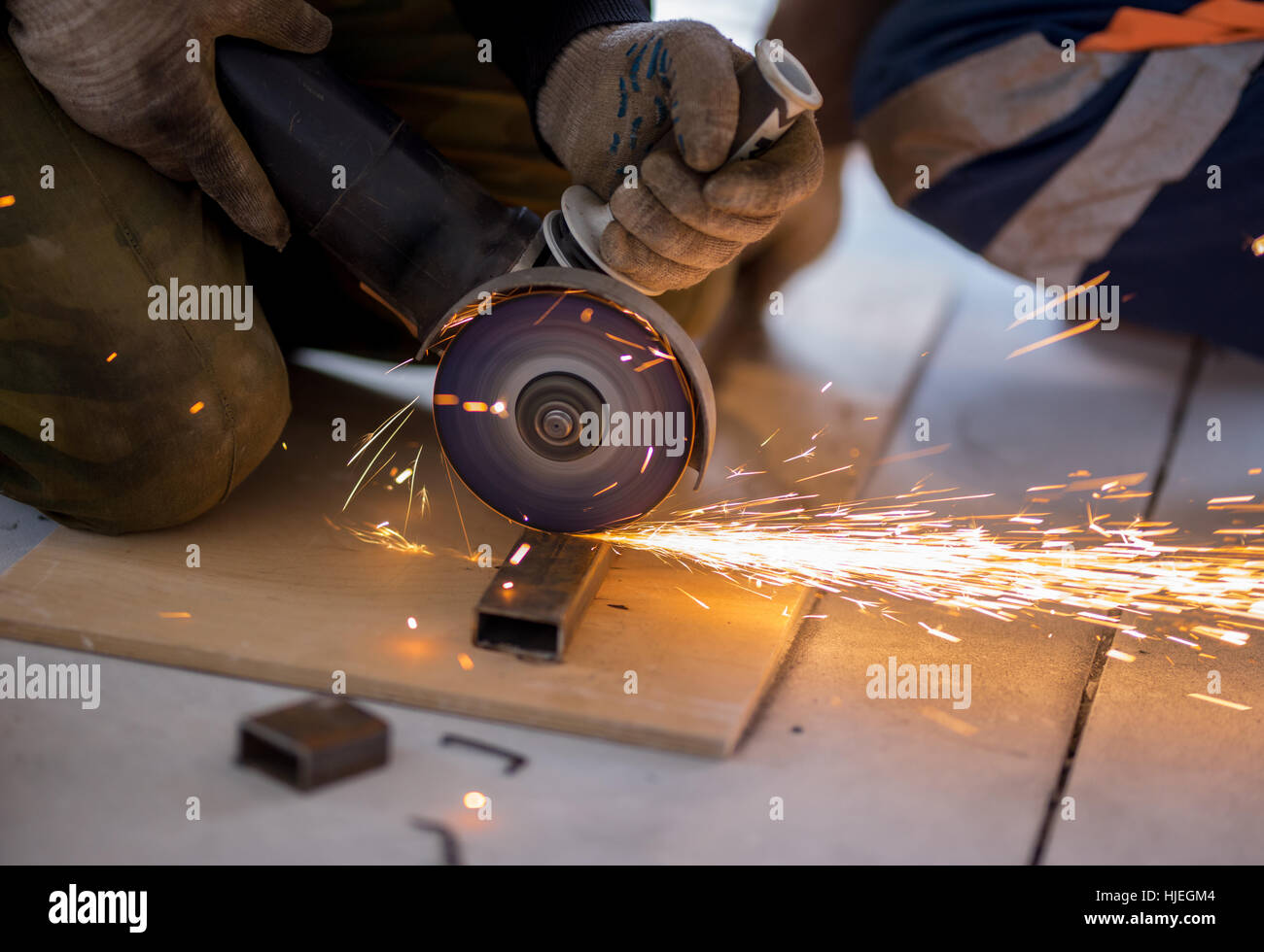 Cutting metal with angle grinder. - Stock Image
