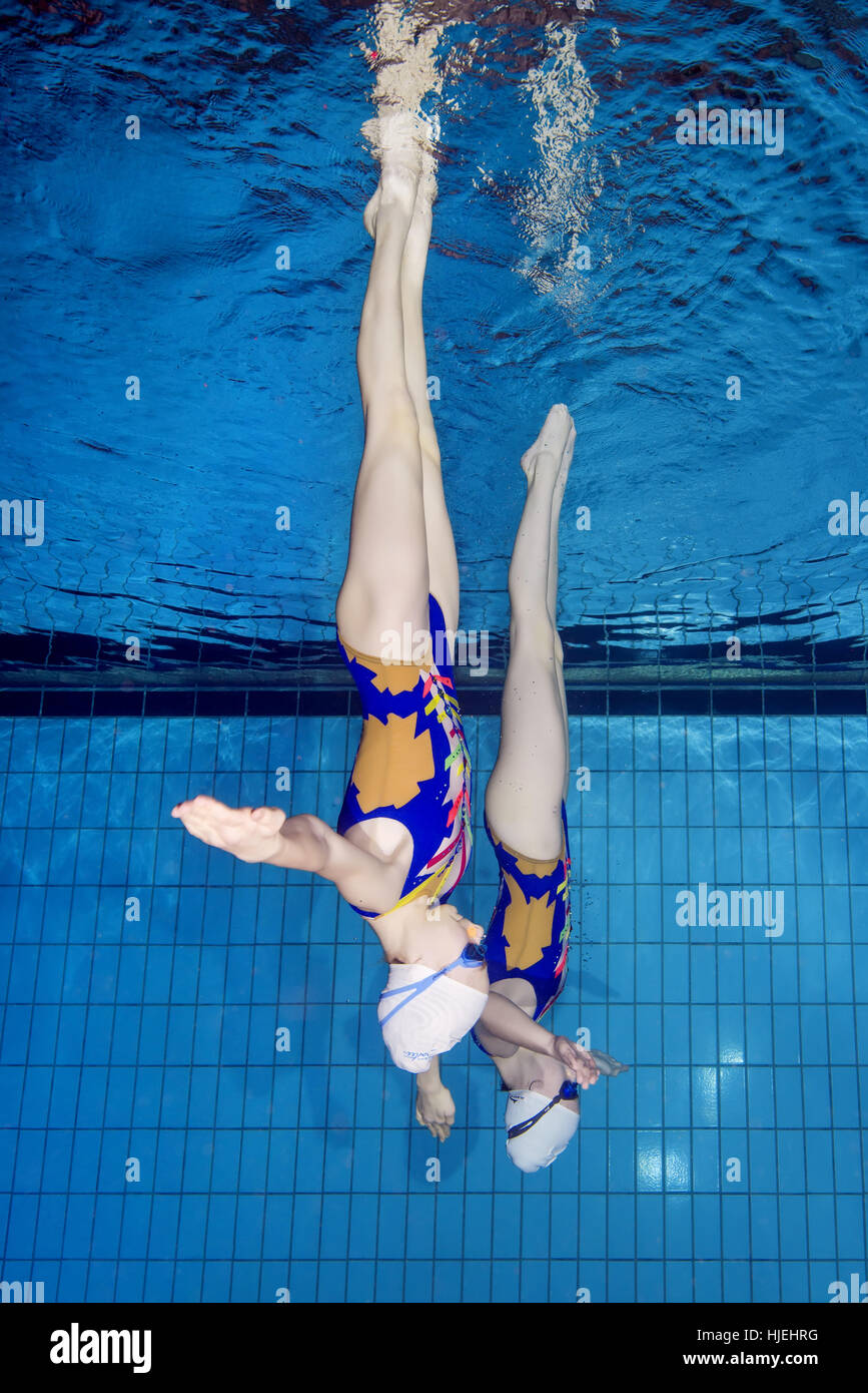 Underwater view of Synchronized Swimming, Nikolaev, Ukraine, Eastern Europe - Stock Image