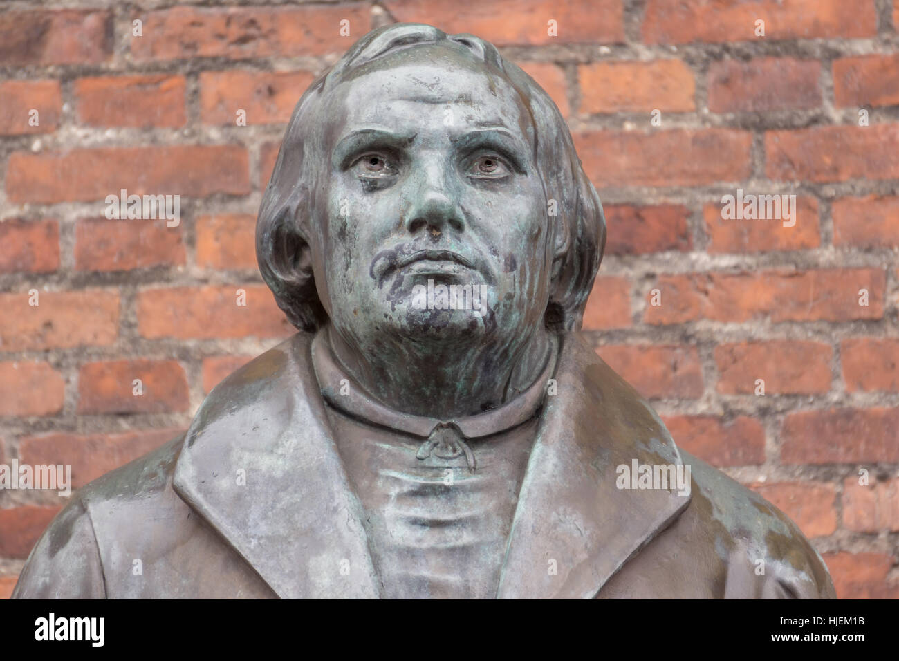 Bronze statue of the reformer Martin Luther in front of Luther church in Copenhagen, Denmark, January 21, 2017, Stock Photo