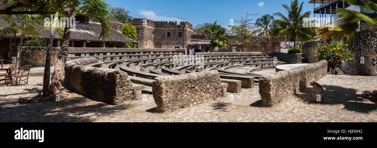 Amphitheatre made of stone in Stone Town, public space used for occasional cultural events, fort near to House of - Stock Image
