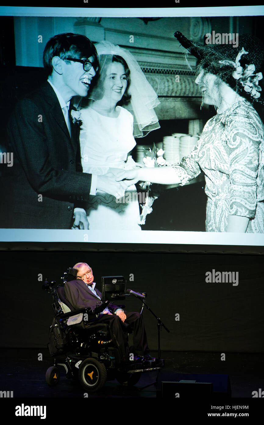 Prof. Stephen Hawking, British scientist, world renowned physicist portrait with his wedding picture in the background, Stock Photo