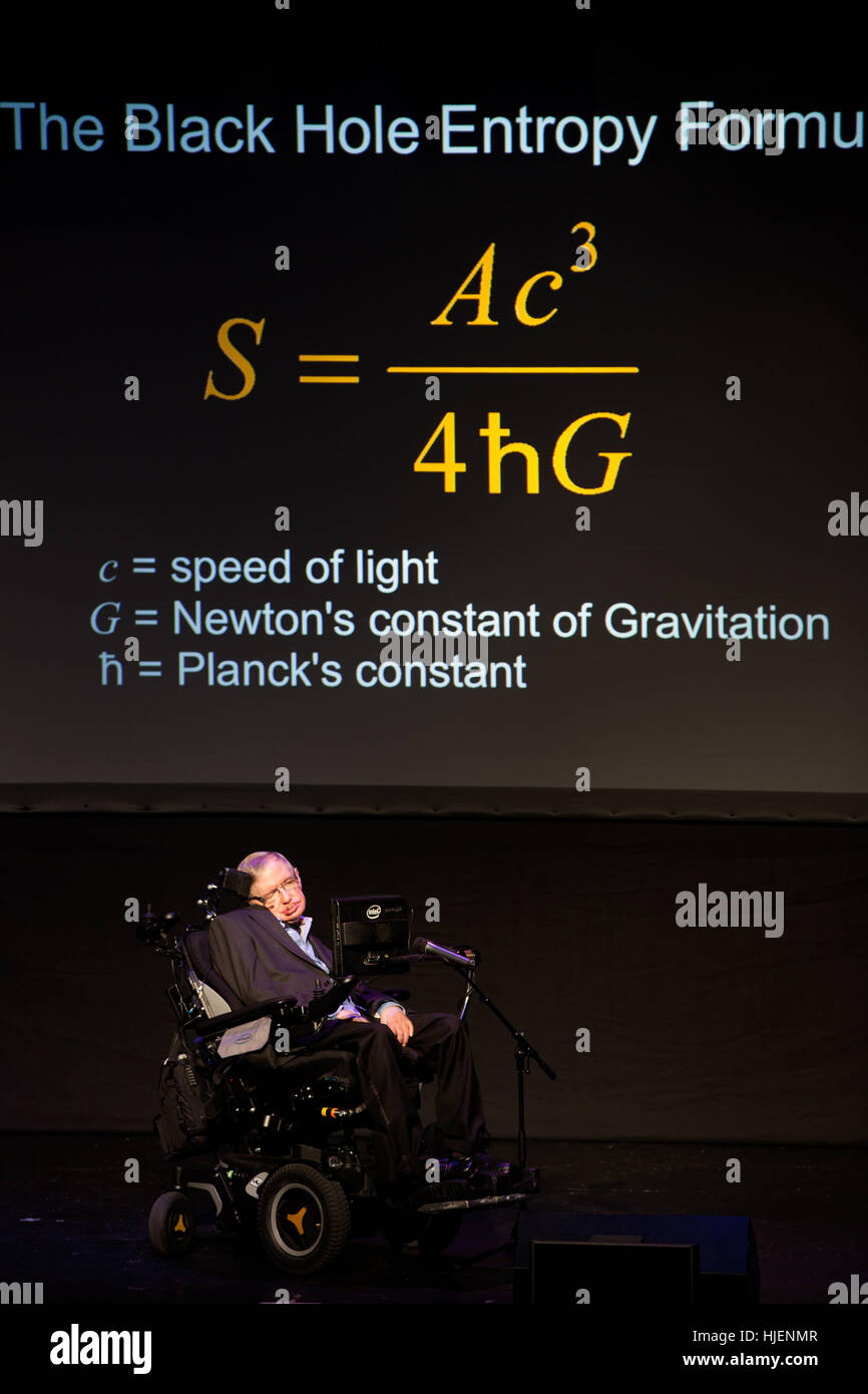 Prof. Stephen Hawking, British scientist, world renowned physicist portrait with the black hole entropy formula Stock Photo