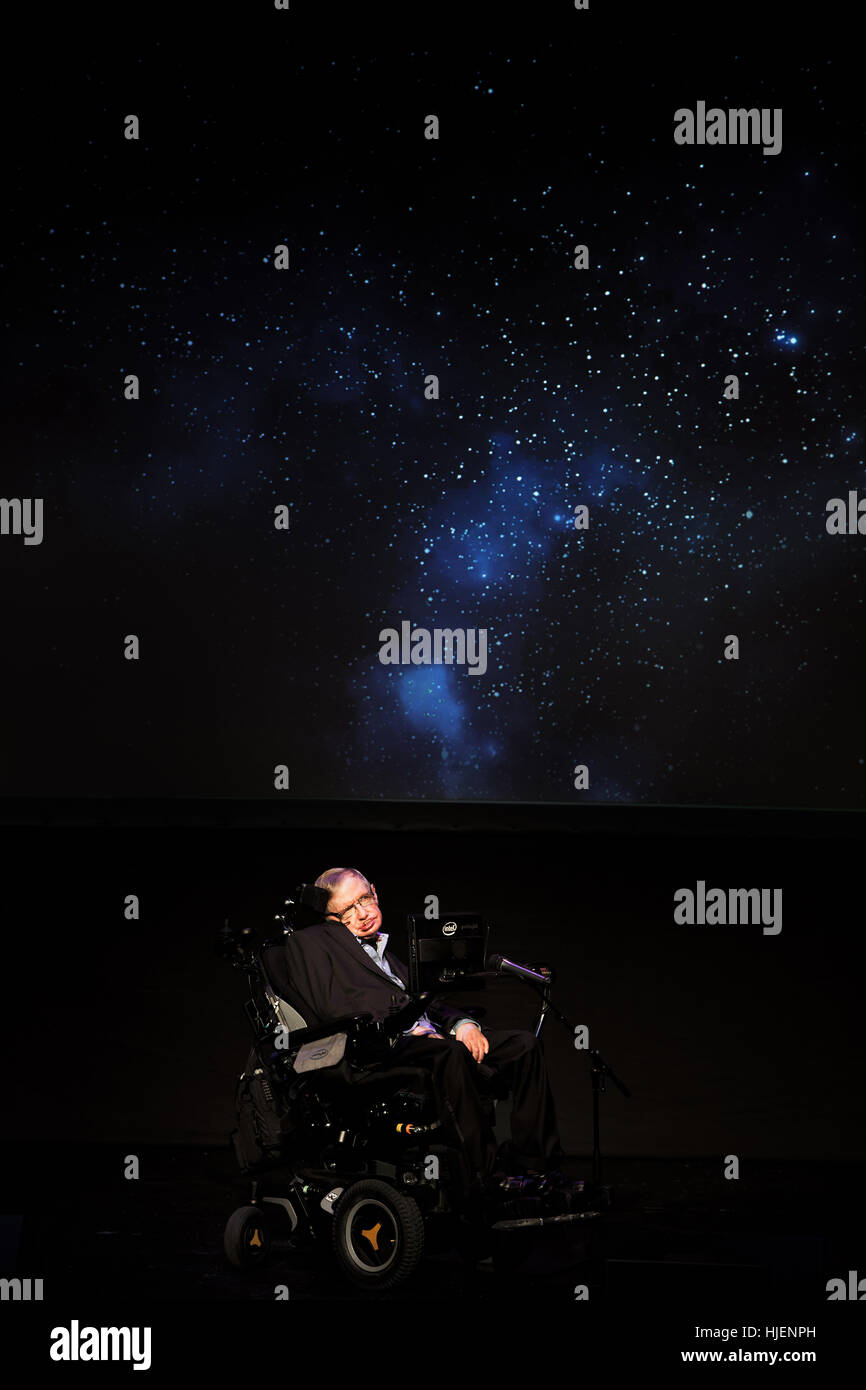 Prof. Stephen Hawking, British scientist, world renowned physicist symbolic portrait with the Universe projection Stock Photo