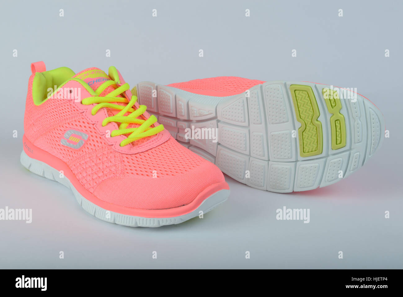 Pair of pink Skechers running shoes cut out isolated on white background - Stock Image