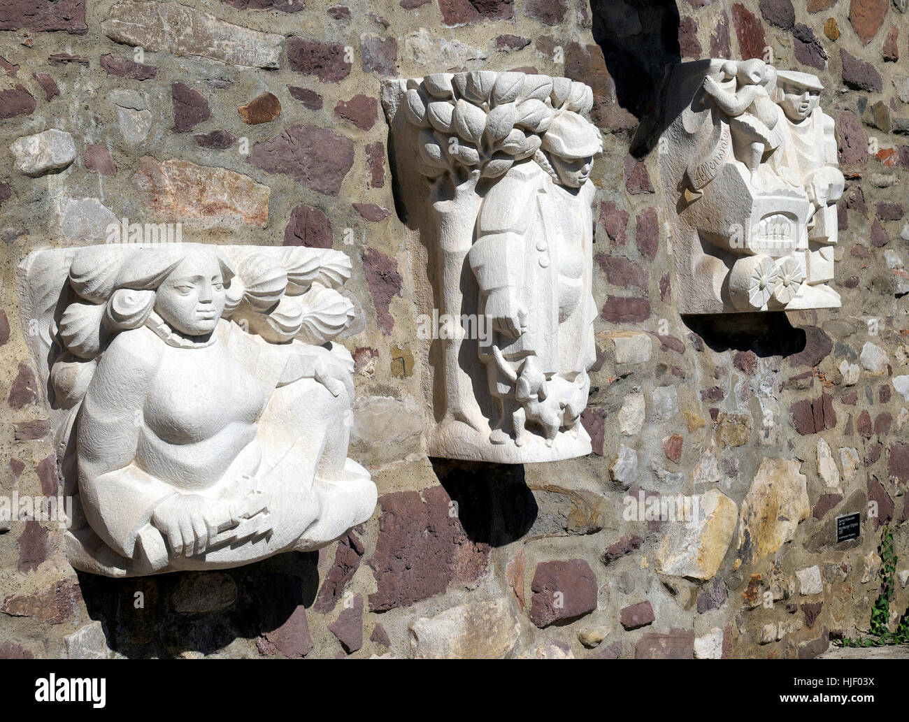 Magdeburg originals on city wall, sculptor Eberhard Roßdeutscher, Magdeburg, Saxony-Anhalt, Germany Stock Photo
