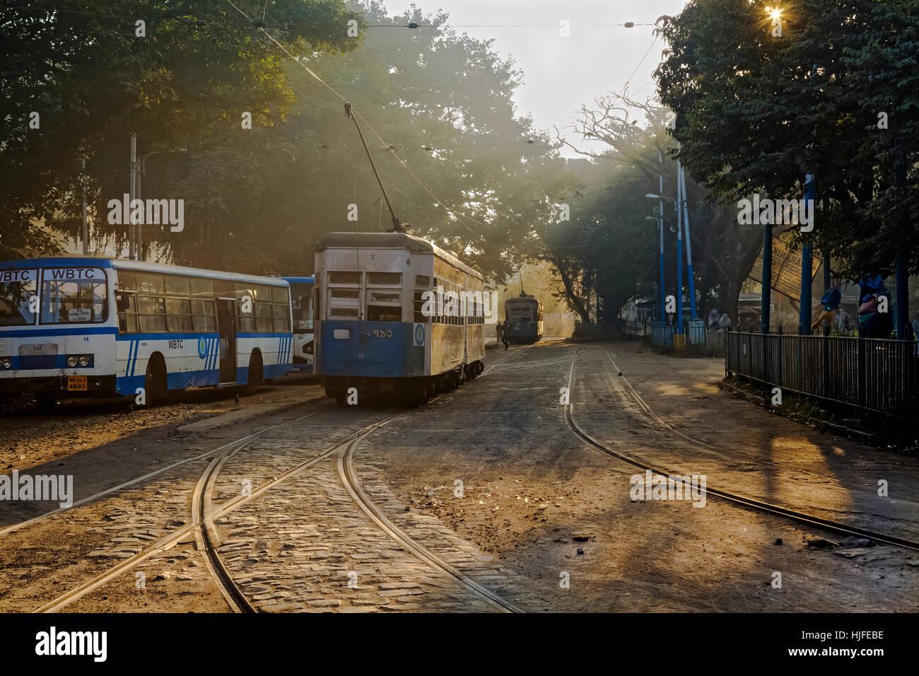 Heritage Kolkata tram standing on the track near a tramway depot at Esplanade, Kolkata on a foggy winter morning. - Stock Image