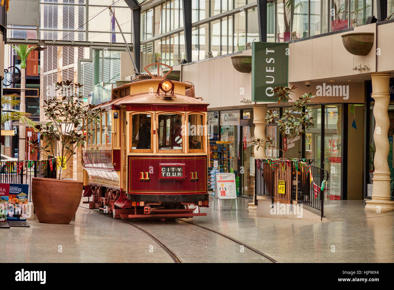 Vintage tramcars in Cathedral Junction, a combined shopping mall and tram stop in the centre of Christchurch, New - Stock Image