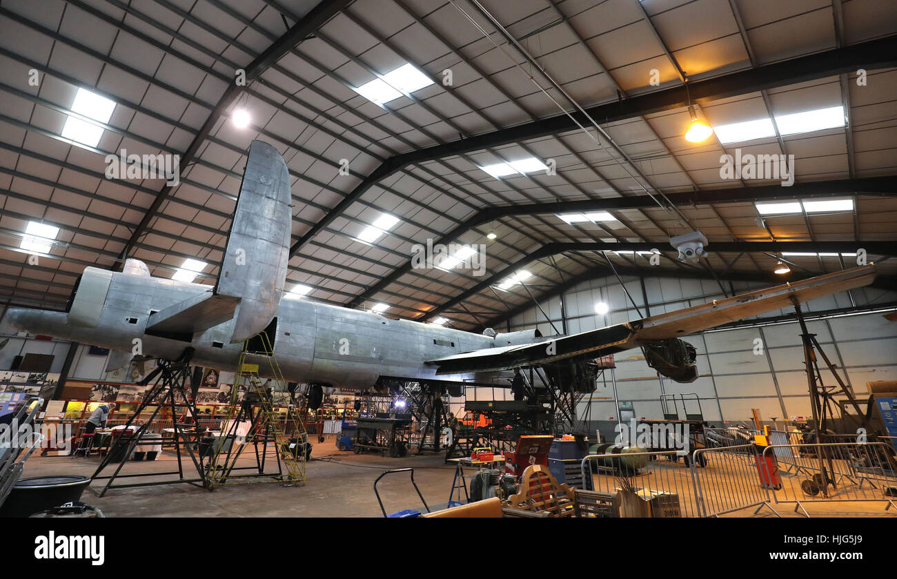 General view of the Avro Lancaster NX611 'Just Jane' as restoration works continue on the aircraft at Lincolnshire - Stock Image