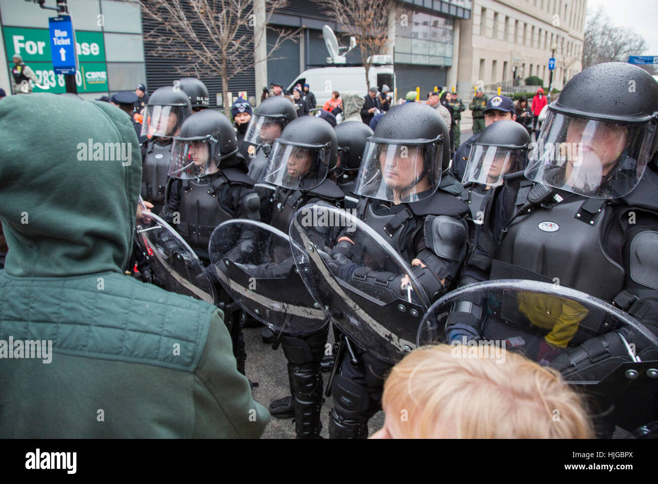 Washington, DC USA - Police in riot gear keep protesters away from a security checkpoint at the inauguration of - Stock Image