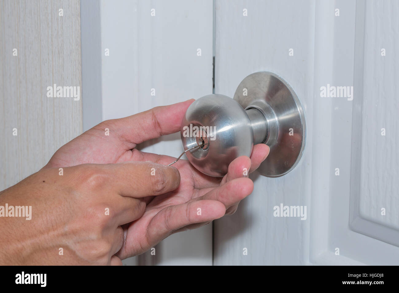 Hand-hold wire and use wire to theft of white door, but it can not be opened because use the locksmith technology. - Stock Image