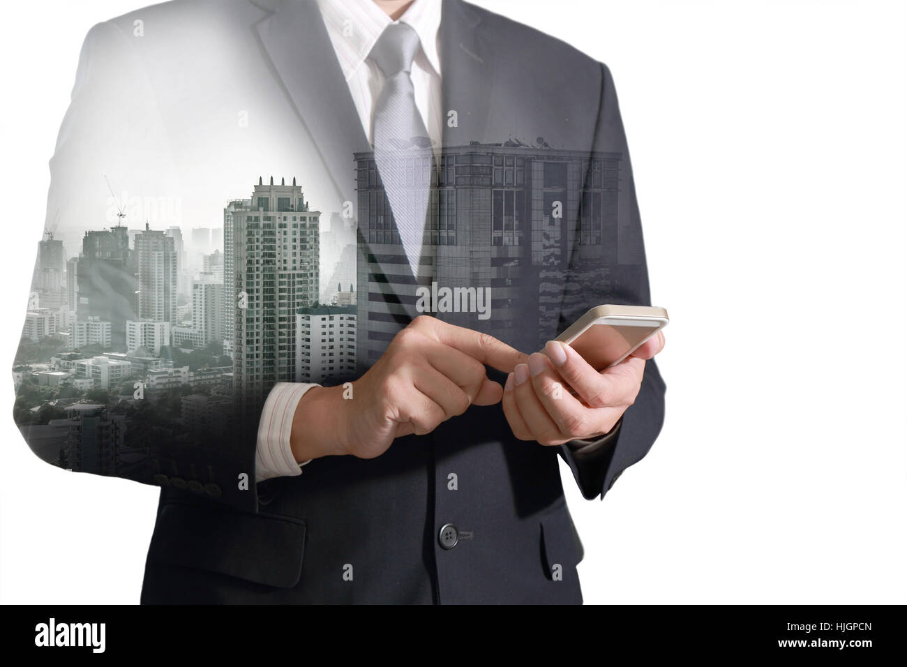 Double exposure of city and business man hand touch screen smart phone as business concept. Stock Photo